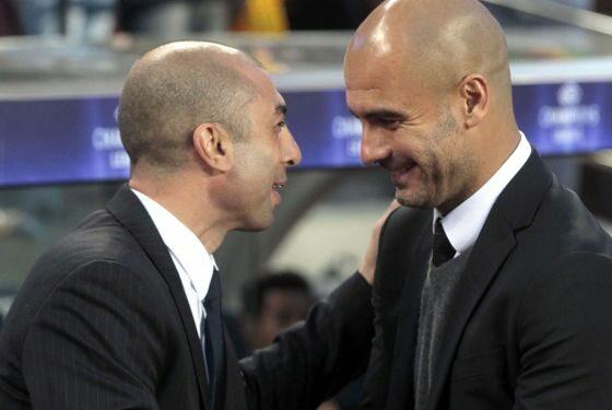 Na początek - wymiana uprzejmości między trenerami (fot. EPA/ALBERTO ESTEVEZ/PAP)